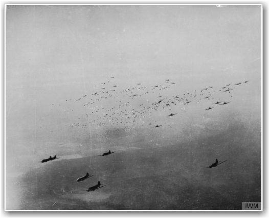CROSSING THE RHINE: C-47 transport planes release hundreds of paratroops and their supplies over the Rees-Wesel area to the east of the Rhine